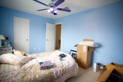 """Before: Bright blue walls and what Sarah calls a """"UFO"""" ceiling fan"""