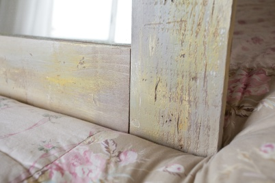 As a last step, make your faux cracks and pits pop by coating them with another bit of dark wood stain.