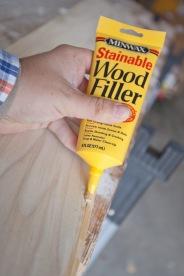 Wood filler pressed into the cracks.
