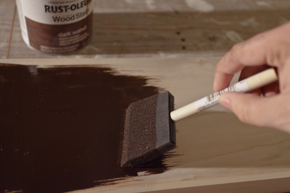 Apply the stain with a sponge brush.